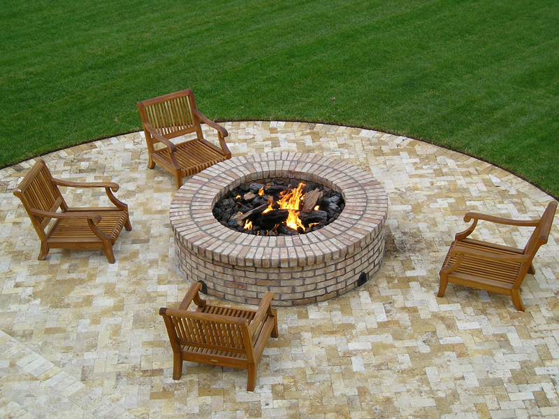 Four Seasons Outdoor Product in W Tan Stone Wood-Burning Fire Pit at Lowe's. Lightweight in concrete wood-burning earth brown fire pit.